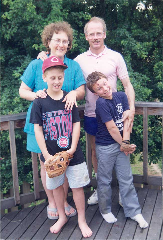 This is a picture of me and my family when I was 9. My parents still claim  that they had no idea I was gay. They're sweet.